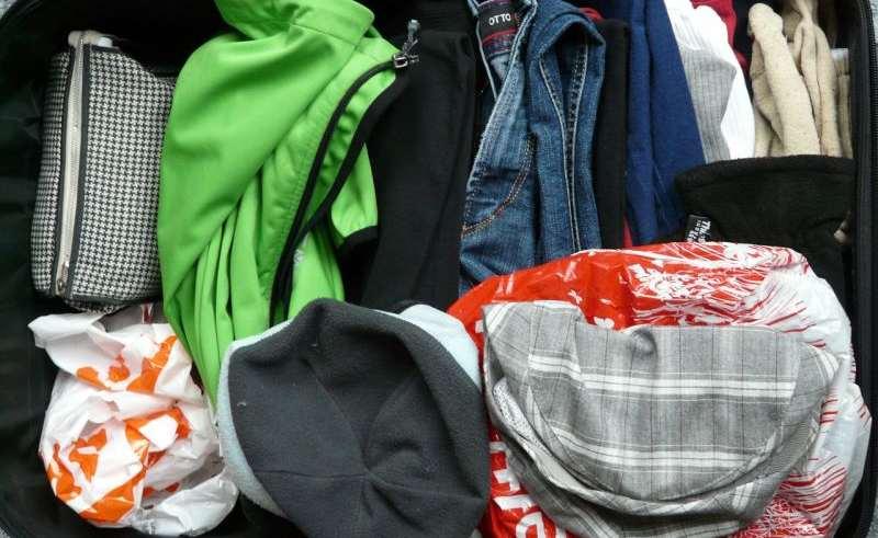 Koffer platzsparend packen: So geht's richtig